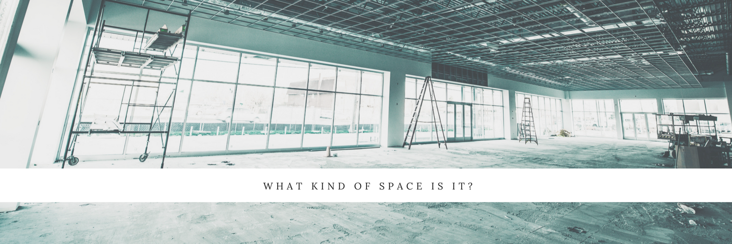 Flooring design ideas from Trinity Surfaces. Empty warehouse with no flooring.